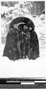Mother Mary Joseph Rogers and Sr. Genevieve Beez standing in the snow with a Japanese woman, Japan, 1927
