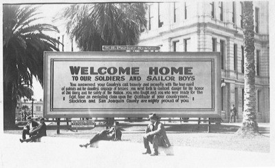 European War, 1914-1918 - Stockton: Welcome Home sign at the end of war, W.R. Parker System Billboard