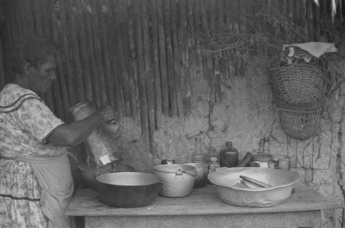 A woman works in the kitchen with grated coco, San Basilio de Palenque, 1976