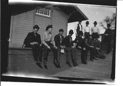 Railroad workers on train station platform in Forestville