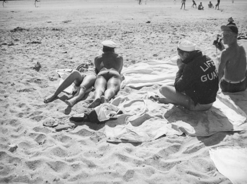Lifeguards relaxing at Newport Beach