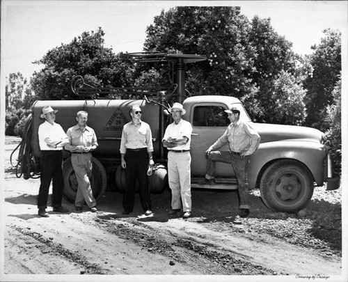 Graves & Howley spray truck rig with Bill Graves, Theron Willis, Ortho tech. rep. Paul Andres, and head mechanic Ernie Dargatz, Tustin, ca. 1960