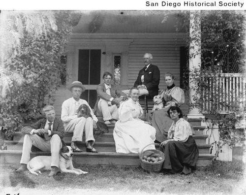 Members of the John Kendall family seated on the porch steps of the family's El Cajon residence