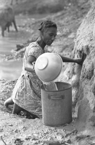 Woman collecting water, San Basilio de Palenque, Colombia, 1977
