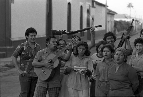 A group of people sing on a street, Nicaragua, 1979
