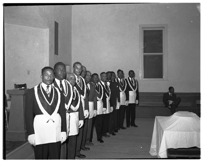 Calisphere: Group of men in masonic aprons standing in line
