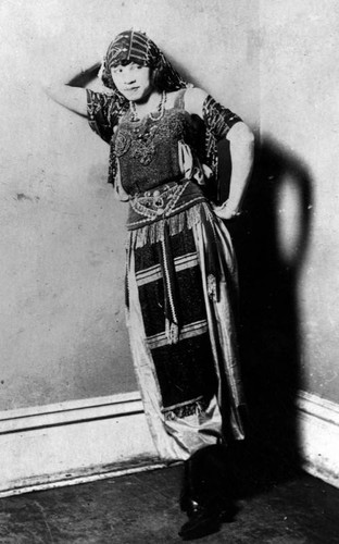 Woman in a beaded and fringed dress
