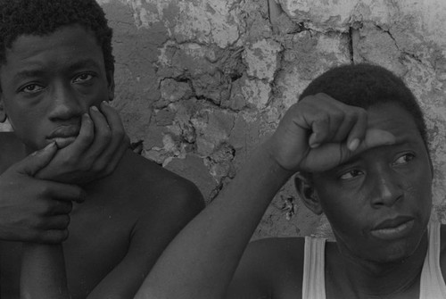 Men sitting in front of a wall, San Basilio del Palenque, ca. 1978
