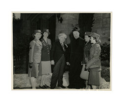 Isidore B. Dockweiler with WAC personnel and Roman Catholic priest, circa early 1940s