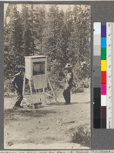 A weather station on the way to the Mt. Hough Lookout. About 6000 ft. elevation. The man on right of picture is Mr. Mitchell, who looks after the Feather River Experiment Station