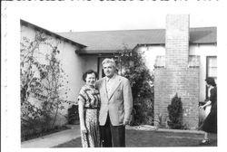 Bunni and George Streckfus in front of a house in Pacific Palisades, April, 1950