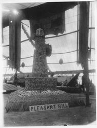 1913 Gravenstein Apple Show display of a lighthouse made of apples sponsored by the Pleasant Hill apple district