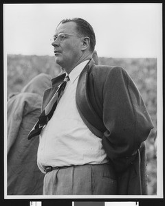 University of Southern California football coach Jeff Cravath on the sidelines at the Los Angeles Coliseum, shot to thigh level, circa 1947-1949