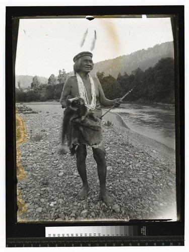 [Indian leader, standing on river bank]