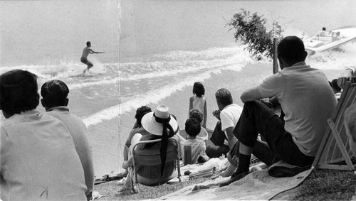 Spectators watch water skiing contest