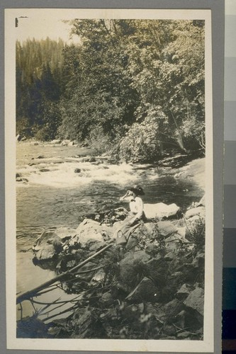 [Unidentified woman at river bank.]