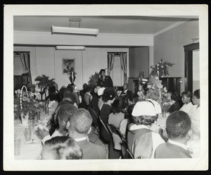 Unidentified group of people at a banquet, COGIC