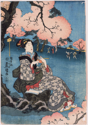 Woman seated beneath a cherry tree