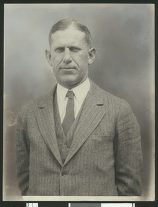 University of Southern California football coach Howard Jones, in pinstriped suit, waist up, 1925