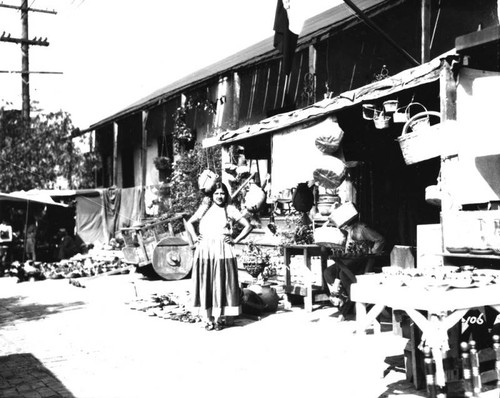 Woman in front of booth, Olvera Street
