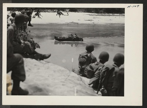 Members of the 232nd engineers observe the maneuvers of one of their amphibians in the Leaf River near Camp Shelby