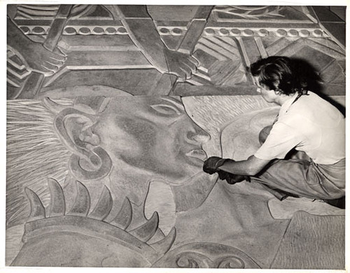 [Artist Esther Bruton working on the mural 'Peacemakers' that will decorate the West walls of the Court of Pacifica, Golden Gate International Exposition on Treasure Island]