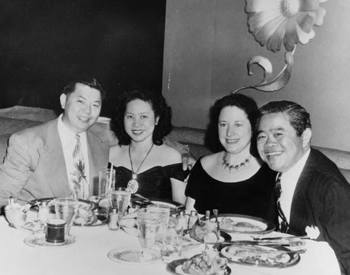 Mr. and Mrs. James Wong Howe (Sanora Babb Howe) dining with friends