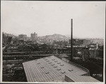[View to northeast from near Rincon Hill toward Telegraph Hill (center). Russian Hill, far left; Merchants' Exchange Building, left center]
