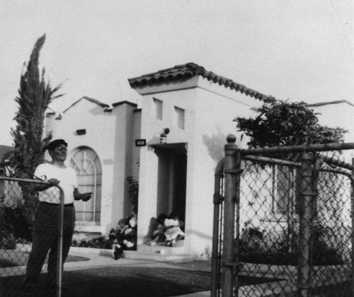 Mexican American man in front of home