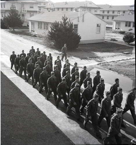 Trainees marching in formation through Fort Ord