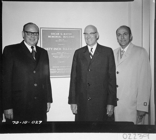The three Mayer brothers standing next to the dedication plaque for the Oscar G. Mayer Memorial building, Palomar Observatory