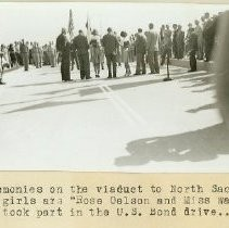 "Ceremonies on the viaduct to North Sacto. The girls are ""Rose Oelson and Miss Wallace who took part in the U. S. Bond drive"