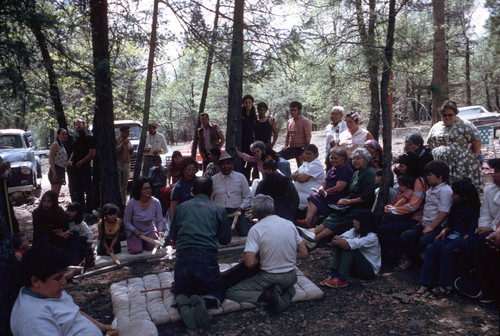 Large group gathered around to watch the grass game at the Greenville Bear Dance--1972 (Cildy and Vilas Bone in the center of group)