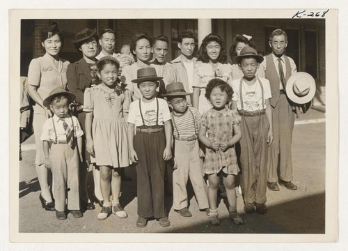 Shown are some arrivals in Madera, California, from the Rohwer Relocation Center. Photographer: Iwasaki, Hikaru Madera, California