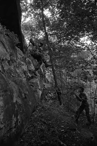 Survival school students learn to rappel, Liberal, 1982