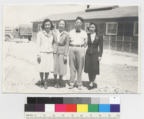 To Yoshi--taken June 15--1943. [My sister (far right) and I, with our parents, on the day of our departure for the outside world. Topaz, 1943.] [CNEGS available.]
