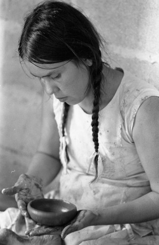 Woman crafting a clay bowl, La Chamba, Colombia, 1975