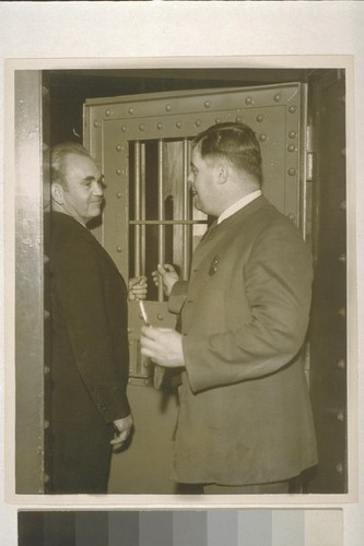 [Tom Mooney and unidentified man at cell door, San Francisco Jail. 1933.]