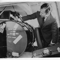Dr. Alvin Marks, pilot and owner of Skymark Airlines. Here, Marks checks on a fuel tank