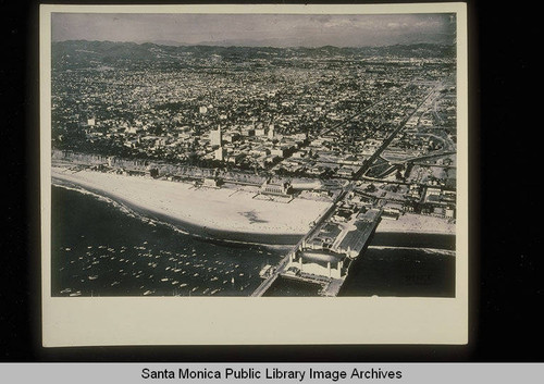 Aerial of the Santa Monica Pier with the La Monica Ballroom and Yacht Harbor looking east to the Santa Monica Mountains on September 3, 1936