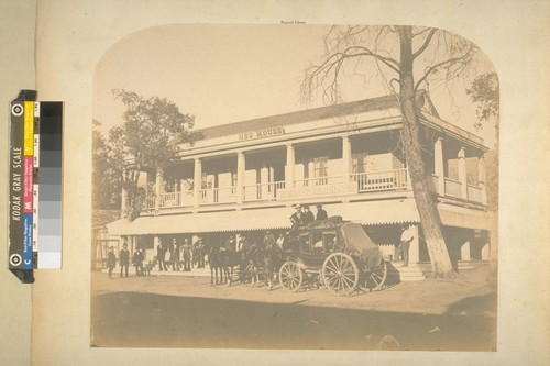 Oso House, Bear Valley. [Several men on porch; coach in front of building near Wells Fargo & co. sign