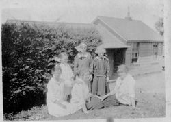Group of four girls with two adult women, friends or relatives of the Riddell family, likely at the Riddell's Bodega Bay house, about 1915