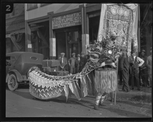 Chinese lion during festival in Chinatown, Los Angeles, circa 1920-1939 —  Calisphere