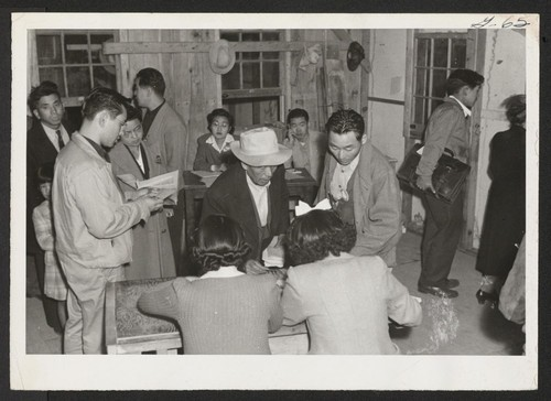 Arrivals from Tule Lake receiving housing accommodations.--INCOMING Photographer: Aoyama, Bud Heart Mountain, Wyoming
