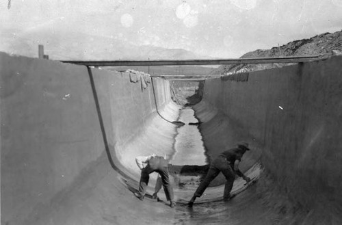 Hand finishing the bottom of the Los Angeles Aqueduct