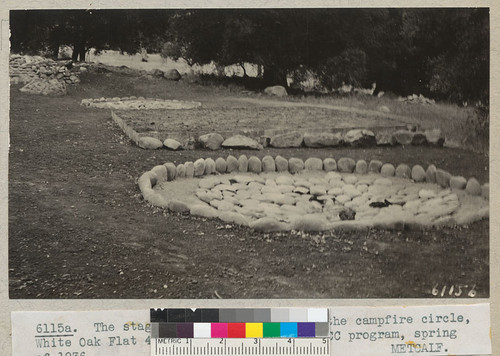 The stage and two fire bowls at the campfire circle, White Oak Flat 4-H Club Camp, built by Civilian Conservation Corps program, Spring of 1936. Metcalf