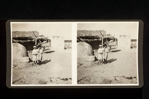 Stereoscope card (Stereographic)--Pueblo Indian children and adobe buildings