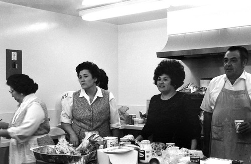 Mr anr Mrs Allen (of Orland) and others in kitchen at the California Indian Education Association Christmas party--1970