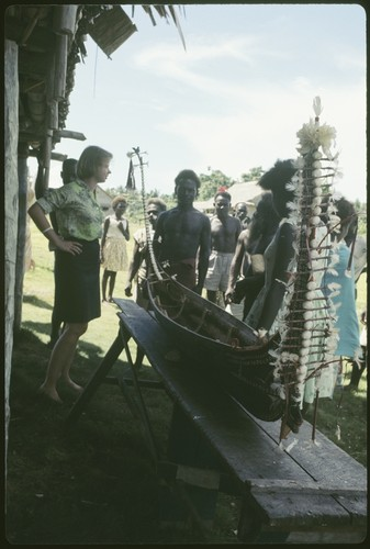Group with miniature canoe