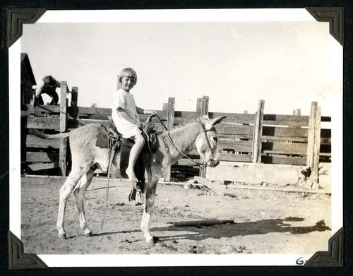 Mildred Christman and her pet burro at the Johnson Ranch at San Antonio del Mar